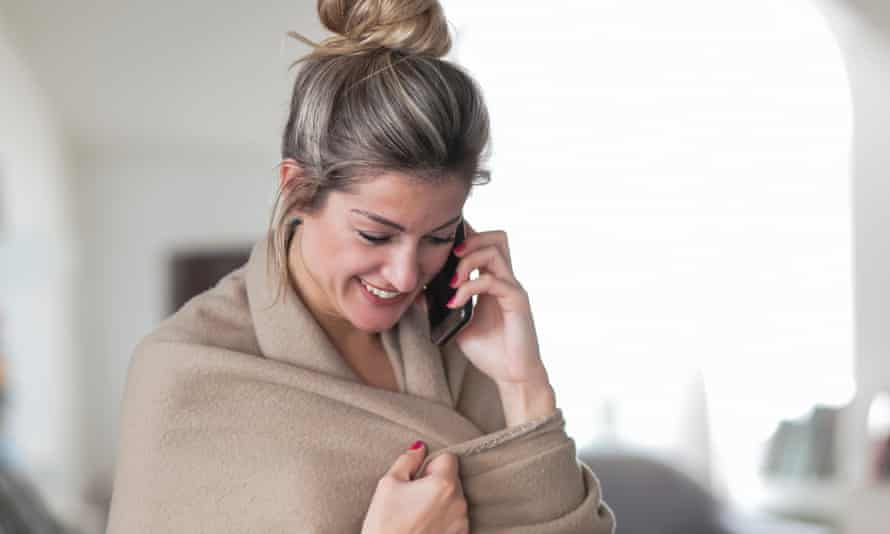 Woman Wrapped In Blanket Talking On Mobile Phone