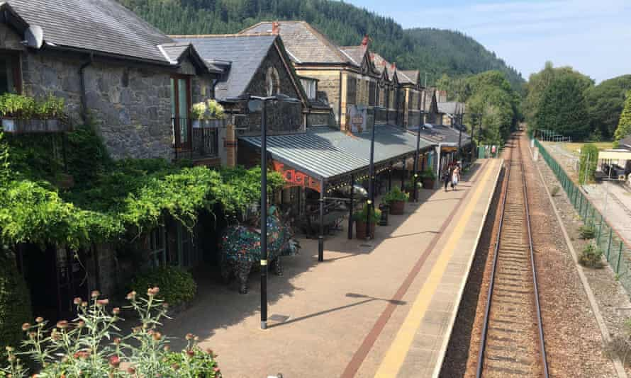 Betws y-Coed station, with flowers and art gallery.