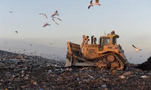 Bulldozer moving garbage