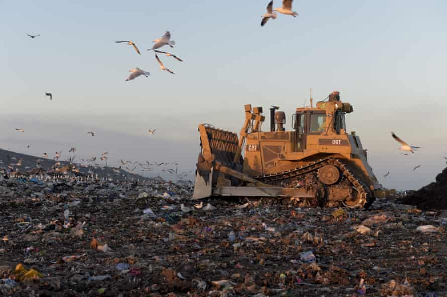 A bulldozer moves garbage at the Melbourne Regional Landfill site.