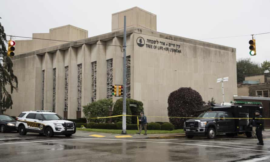 Police stand guard outside the Tree of Life synagogue.