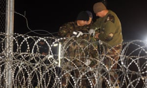 Hungarian police and soldiers close the border between Hungary and Croatia with barbed wire and a fence Hungary