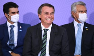 Brazilian President Jair Bolsonaro smiles during the launch of the national vaccination plan on 16 December.