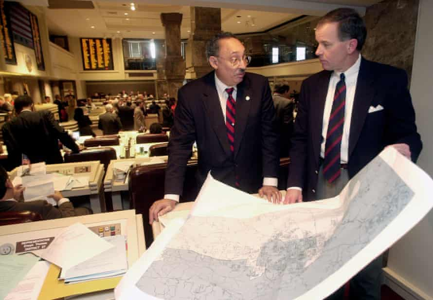 Alabama state Rep. Thad McClammy and Rep. Greg Wren look over a printed map of a congressional redistricting plan in January 2002.
