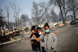 Sandra, Daniela, and Ester Reyes are seen after wildfires destroyed a neighbourhood in Bear Creek, Phoenix, Oregon, U.S., September 10, 2020.