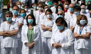 Staff from La Paz hospital observe a minute's silence to remember Joaquin Diaz, the hospital's chief of surgery who died of Covid-19.