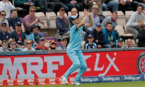 England's Chris Woakes takes a catch to dismiss West Indies' Andre Russell.