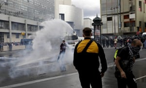 Police use a water canon on protestors during a demonstration in Paris. Demonstrators gathered in several cities in France on Saturday to protest against the COVID-19 pass, which grants vaccinated individuals greater ease of access to venues.