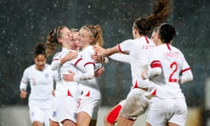 England's players rush to congratulate Leah Williamson (centre) after she scored the Lionesses' third goal, her first for the national side.