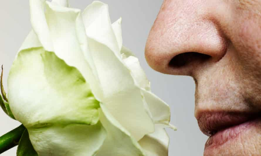 A man smelling a rose