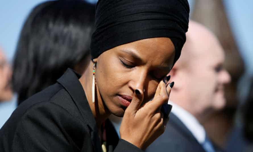 Representative Ilhan Omar wipes tears during a news conference by members of Congress 'to announce legislation to repeal Trump's existing executive order blocking travel from majority Muslim countries'.