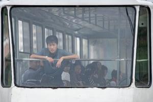 A commuter rides a tram in Pyongyang, North Korea