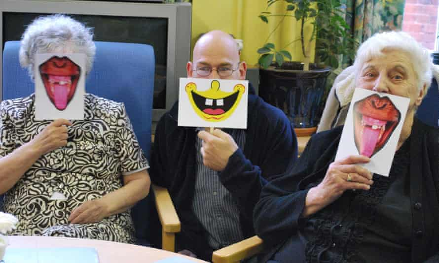 Rob Gee runs a laughter session with elderly people in Leicester.