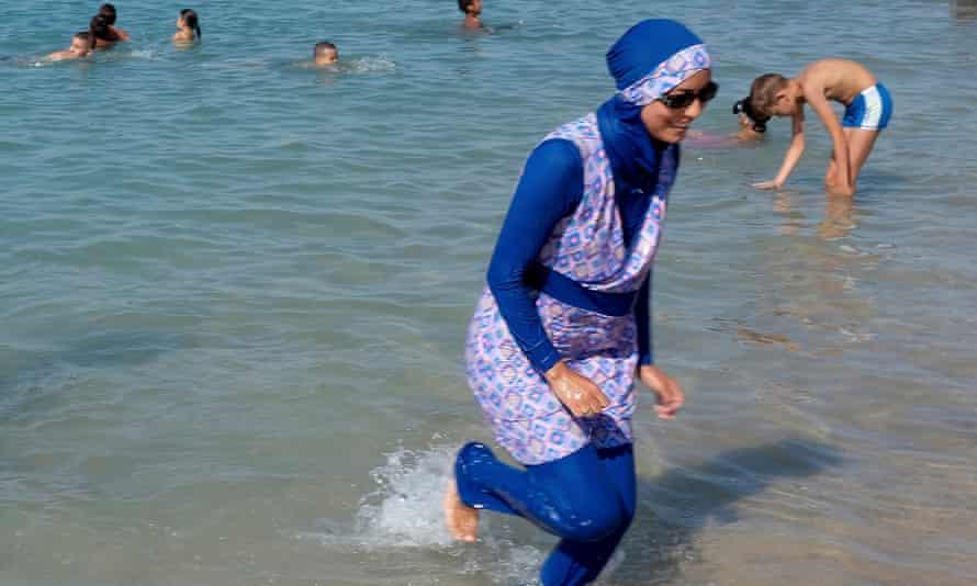 A woman wears a burkini on the beach in Marseille, France.