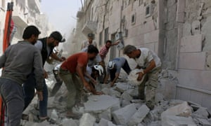 Rescue workers work the site of airstrikes in the al-Sakhour neighbourhood of the rebel-held part of eastern Aleppo.