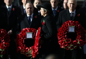 The prime minister, Theresa May, lays a wreath during the remembrance service at the Cenotaph