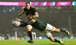 Bryan Habana of South Africa touches down a New Zealand kick over the try line.