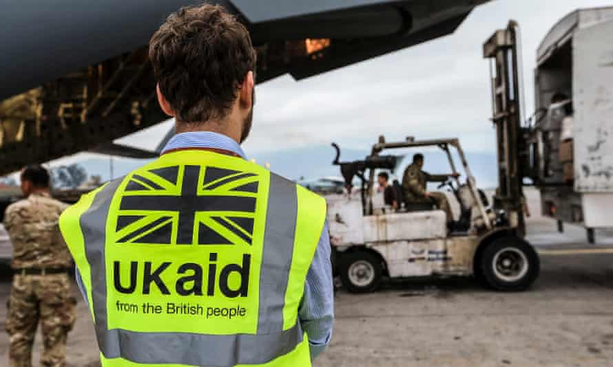 A DfID staff member supervises the unloading of UK aid from an aircaft in Kathmundu, after the Nepalese earthquakes in 2015.