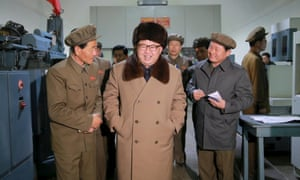 Leader Kim Jong-un smiles during a visit to the Sinhung Machine Plant in Pyongyang.