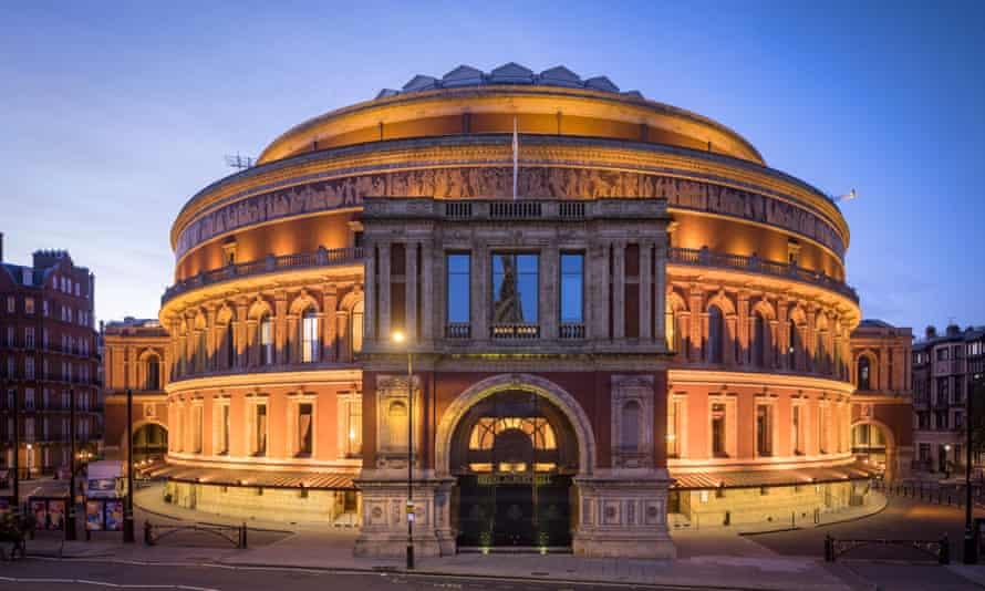 Royal Albert Hall, London, at dusk, and illuminated. UK.