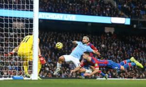 Manchester City's Sergio Aguero marks the team's draw.