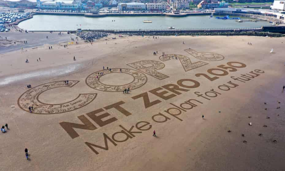 A giant sand artwork adorns New Brighton Beach, in Wirral, Merseyside, to highlight global warming and the forthcoming Cop26 global climate conference.