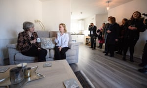 Theresa May meeting first-time buyer Laura Paine (centre) as reporters, security and Downing Street staff look on, during a visit to new housing development, Montague Park in Wokingham, today. Paine benefited from the stamp duty cut for first-time buyers announced in the budget.