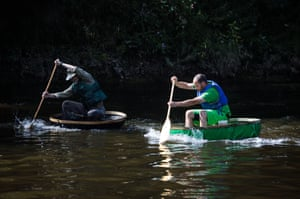 Coraclers race in the Ironbridge Coracle Regatta on the River Severn