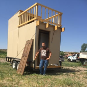 Jim Burleson with a tiny home he built.