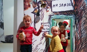 Children explore Winnie-the-Pooh drawings at the V&A Museum in south-west London.