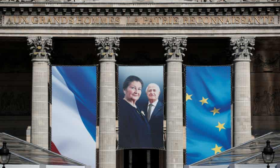 Auschwitz survivor and French minister Simone Veil and her late husband Antoine Veil on a giant banner on the Pantheon in Paris.