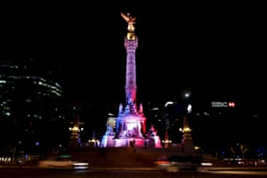 In Mexico City, the Angel de la Independencia monument is lit up in blue, white and red.