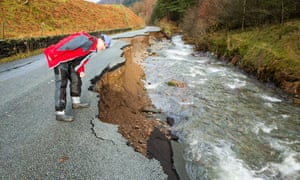 A Cumbria road destroyed in floods during Storm Desmond, which scientists found had been more 40% likely by climate change.