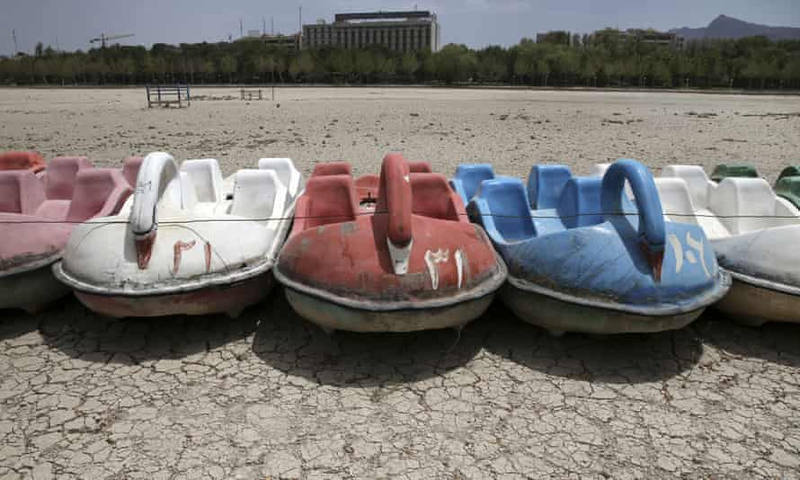 A row of paddle boats sit on the parched Zayandeh Roud riverbed, in Isfahan, Iran.
