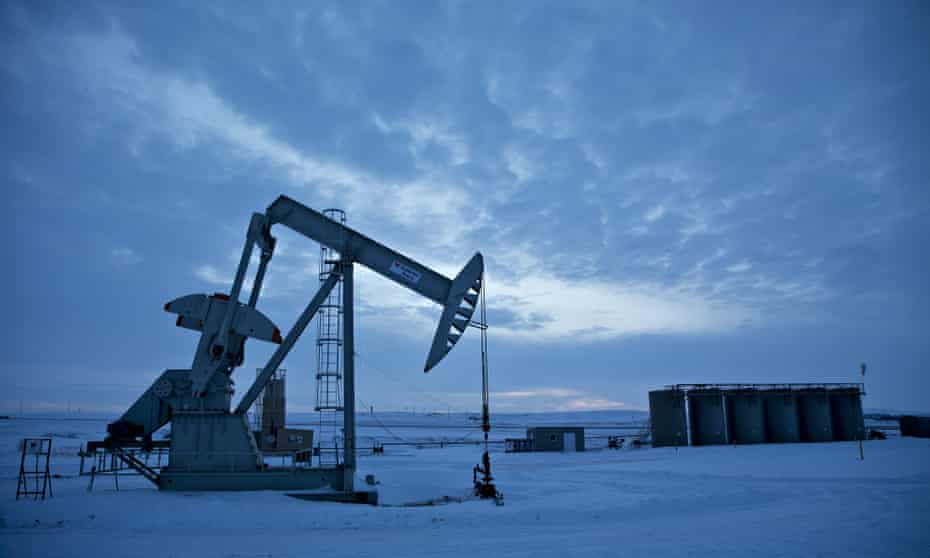 A pumpjack operates above an oil well in the Bakken Formation outside Williston.