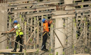 Construction men work on a shopping centre