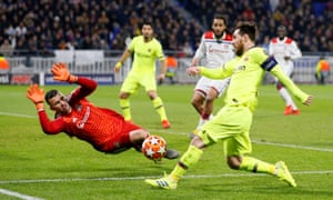 Lyon's Anthony Lopes makes a save from Barcelona's Lionel Messi.