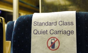 Train seat with standard class quiet carriage label