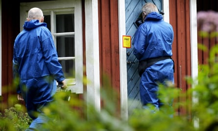 Crime scene investigators outside the farmhouse in Axeltorp, southern Sweden.