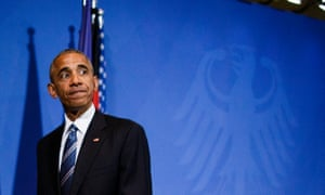 Barack Obama leaves a press conference with German Chancellor Angela Merkel.