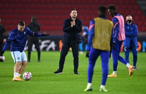 Frank Lampard looks on as his Chelsea players warm up.