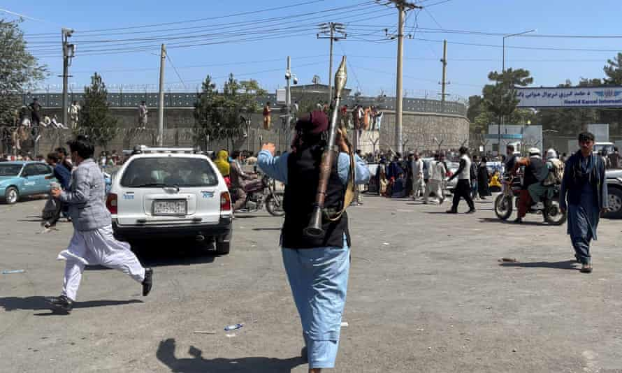 A member of Taliban forces inspects the area outside Hamid Karzai International Airport in Kabul, on Monday.