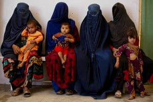 Afghan refugees, who have been forced to leave Pakistan and return to Afghanistan, wait to have vaccinations at a UNHCR reception centre on the outskirts of Kabul, 29 September 2016