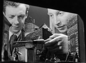 Benjamin Britten (left) inspects a miniature set design for a production of Peter Grimes with stage producer Eric Crozier, June 1945.