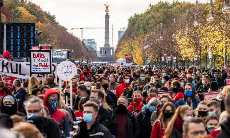 Protesters gather at Brandenburg Gate in Berlin