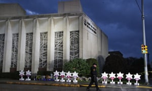 Tree of Life Synagogue and memorial of flowers and stars in remembrance of the those killed and injured when a shooter opened fire during services Saturday.