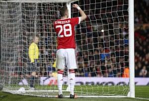 United's Morgan Schneiderlin rues his miss.