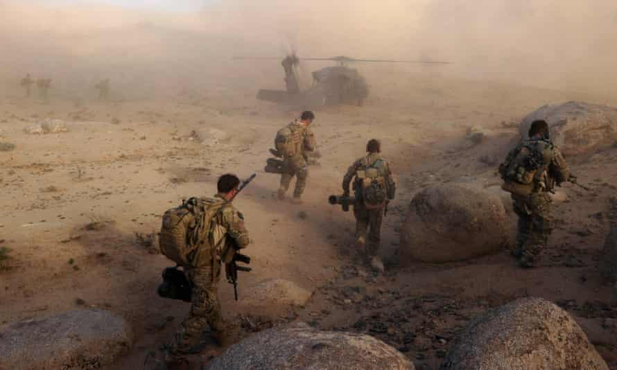 Australian and Afghan forces work to clear a Taliban stronghold in Afghanistan's Kandahar province in 2013