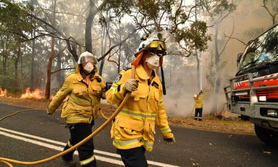 Firefighters conduct back-burning on the New South Wales Central Coast, 10 December 2019