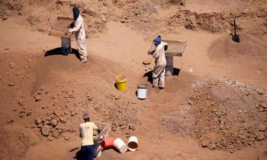 """Illegal diamond miners known locally as """"zama-zamas"""" are seen from the air as they work in Kimberley, South Africa, 22 October 2019."""